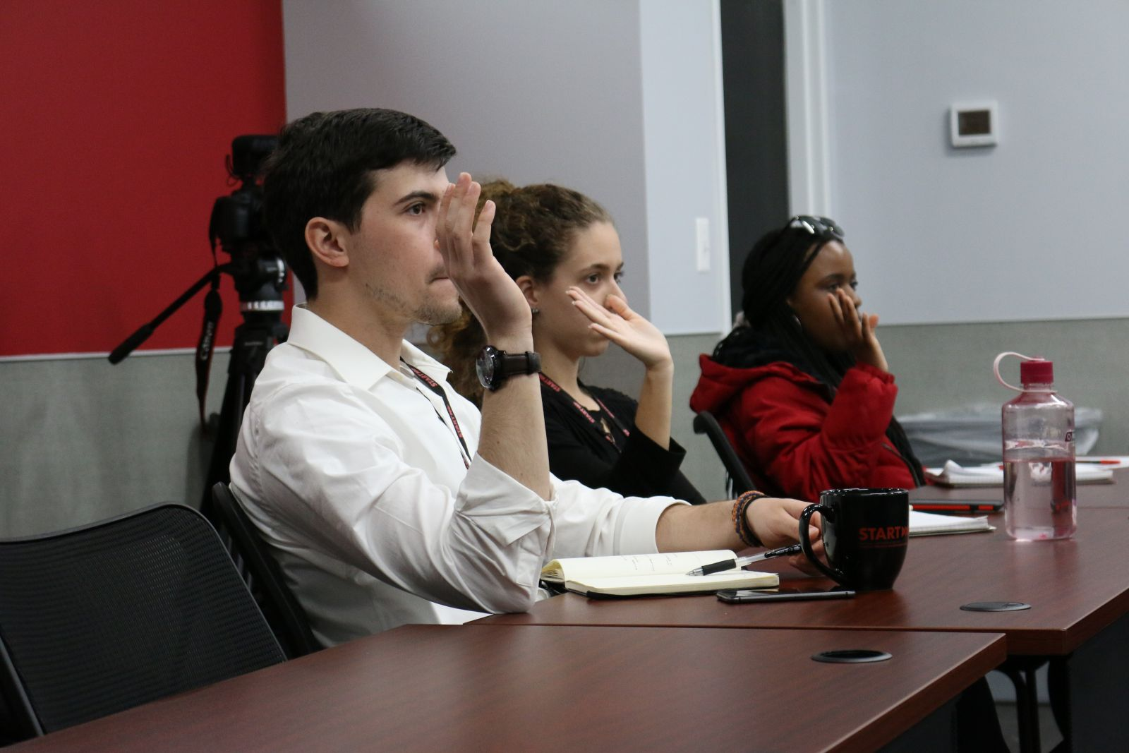 Students participate in a discussion at START